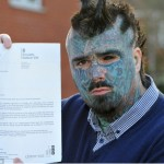 Tattooed man and passport application