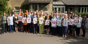 Hospice staff celebrating their outstanding rating from the CQC