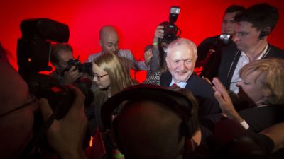 Jeremy Corbyn is surrounded by media and has he celebrates his victory following the announcement of the winner in the Labour leadership contest between him and Owen Smith at the ACC Liverpool.  PRESS ASSOCIATION Photo. Picture date: Saturday September 24, 2016. See PA story LABOUR Main. Photo credit should read: Danny Lawson/PA Wire