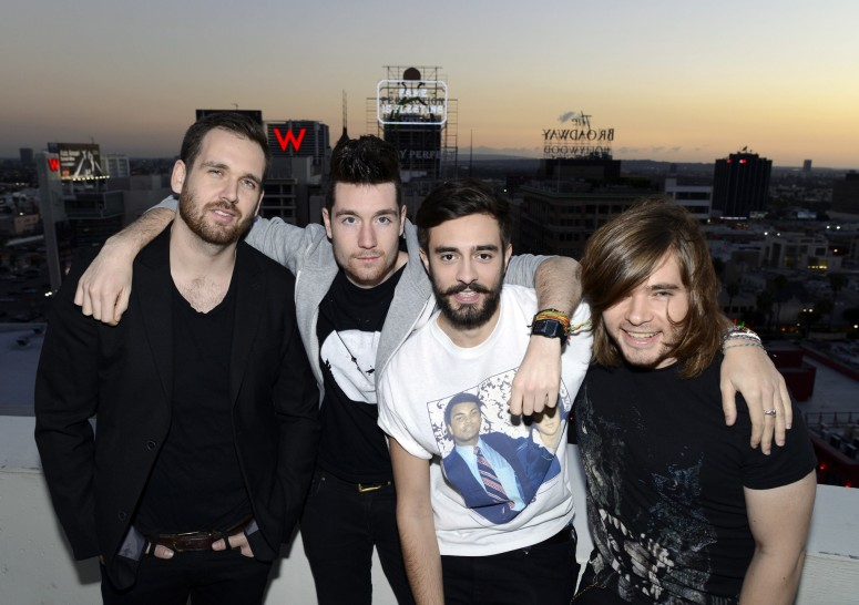 """(From L to R) Members of the British electro-pop band Bastille, Will Farquarson, Dan Smith, Kyle Simmons and Chris 'Woody' Wood, pose for pictures at Capitol Studios in Los Angeles December 5, 2013. When writing a song that imagined a conversation between two ancient ashen corpses, Bastille never imagined it would become the track that led them into the American mainstream music scene. """"Pompeii,"""" a haunting and grandiose song of love and loss, has become London band Bastille's breakout hit, scaling the Billboard Hot 100 singles chart to a peak of No. 10. Picture taken December 5, 2013. REUTERS/Phil McCarten (UNITED STATES - Tags: ENTERTAINMENT PROFILE)"""