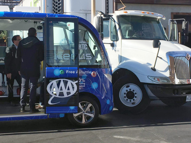 This photo by KVVU reporter Kathleen Jacob shows a driverless shuttle bus after it collided with a big rig in Las Vegas Wednesday, Nov. 8, 2017, less than two hours after the automated ride service was launched. Police say no injuries were reported. It's not yet clear what caused the wreck. (Kathleen Jacob/KVVU-TV via AP)
